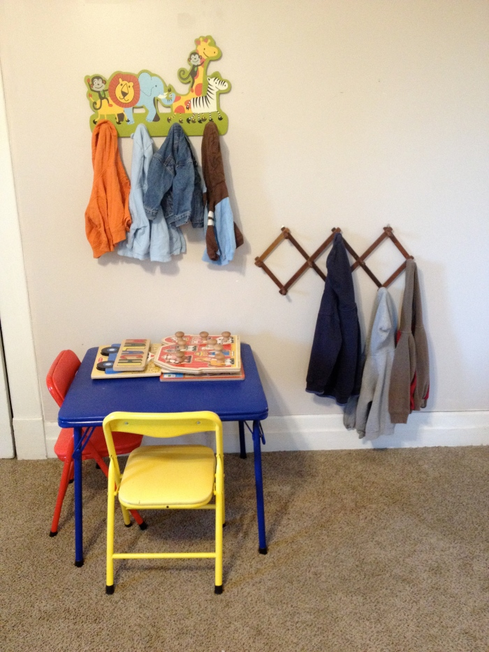 Mini table and chairs. Hooks for toddler at his level. Baby hooks at parent level.