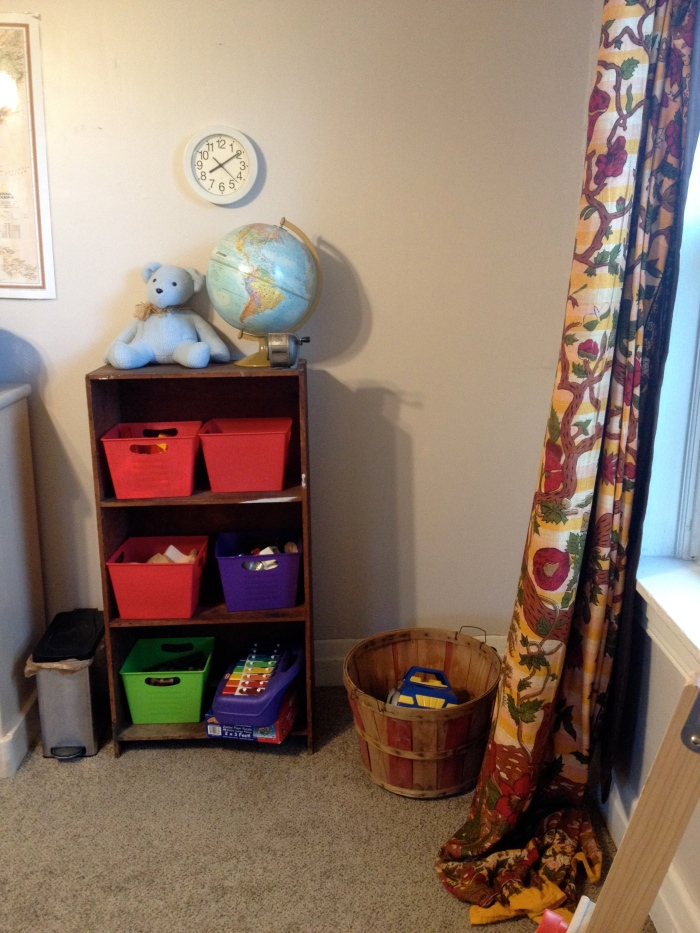 All the toys fit right here except for one basket downstairs. Books are on the other shelf.